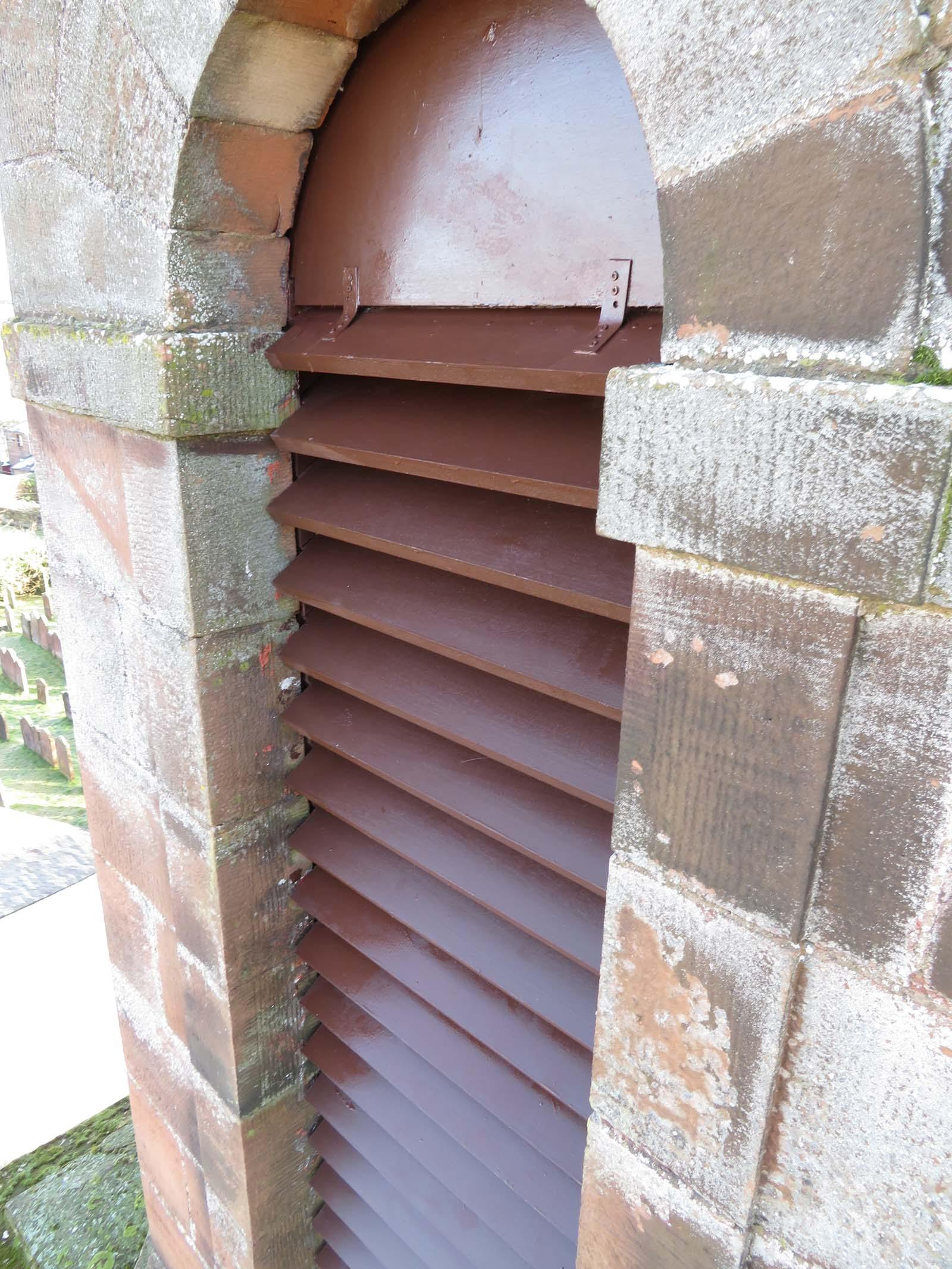 Sapele hardwood louvres installed and painted with 3 coats of paint on a Dumfriesshire church steeple