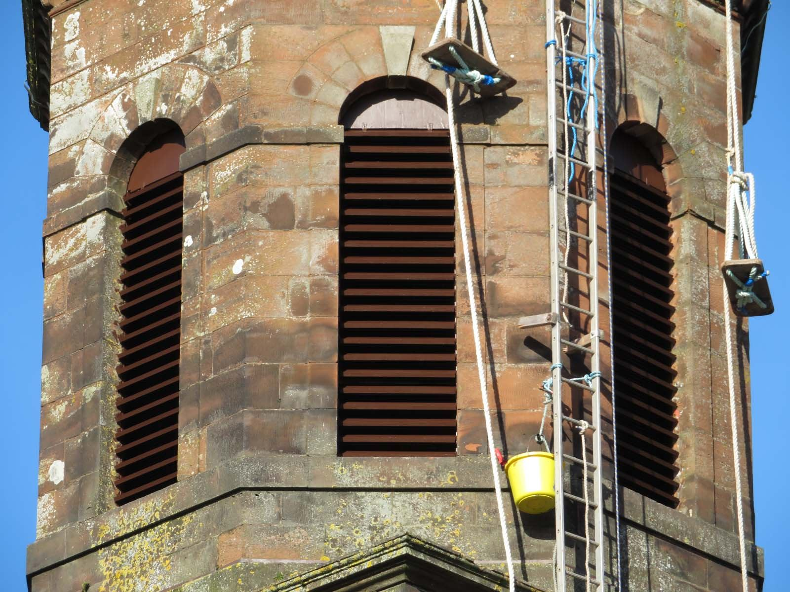 High quality steeplejack installation of sapele hardwood timber louvres on a church spire
