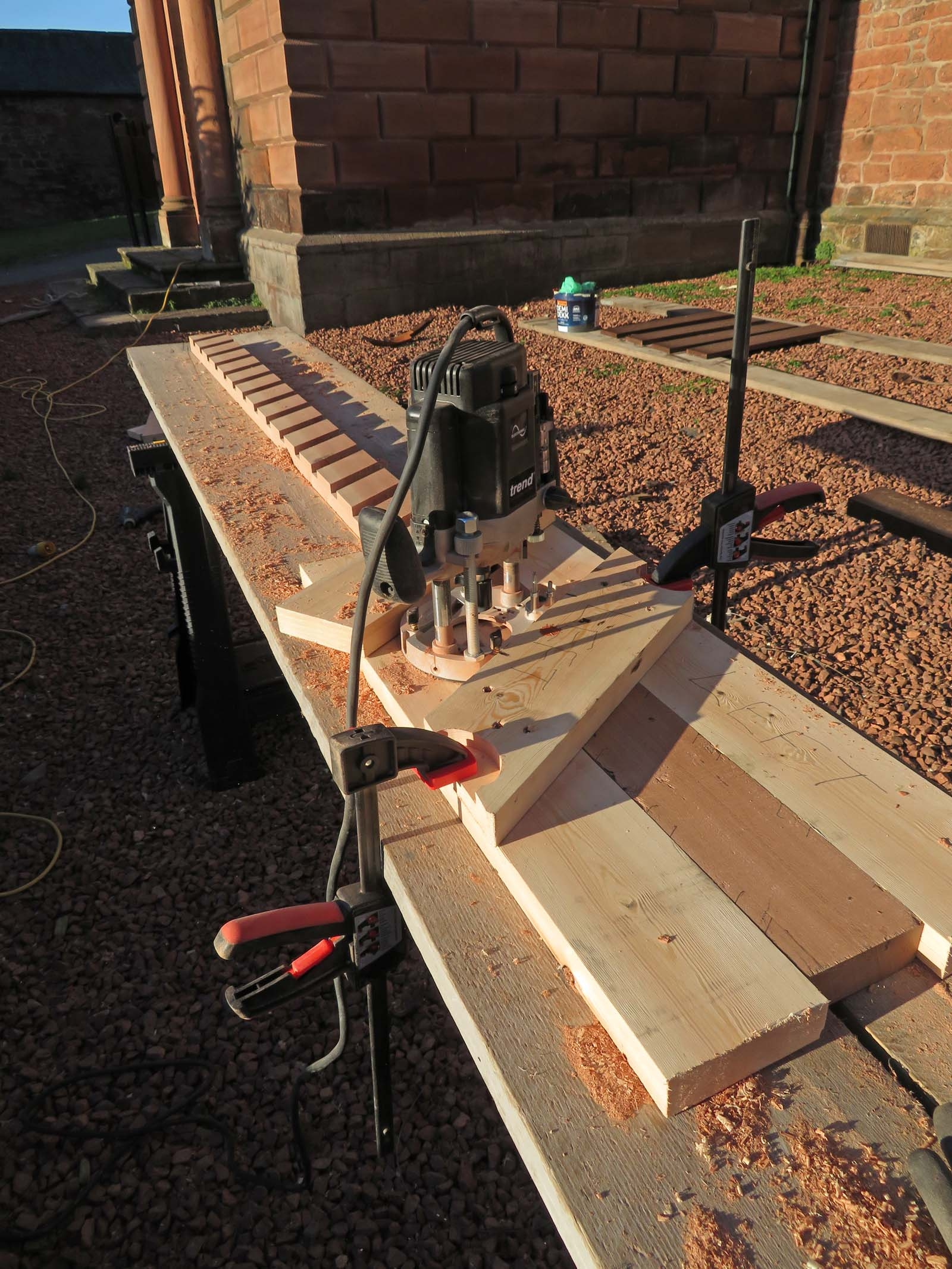 using router to cut louvre slats into timbers