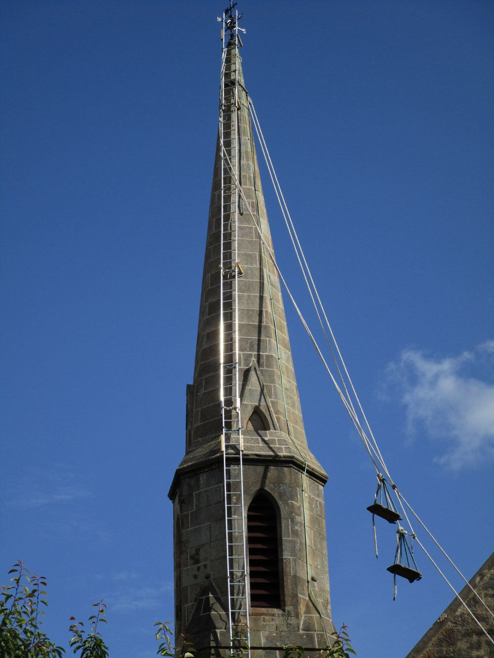 A view of the spire near completion of the work, lime pointing, stabilisation, copper cramps, Scotland