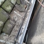First section of cast iron gutter fitted